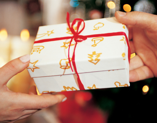 Close-Up of Present Being Handed Over at Christmas